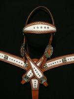 Chestnut Leather, White cowhide, silver dots, Black Diamond Swarovskis (round and Mosaic Tiles) and antique hardware. Very Classy!