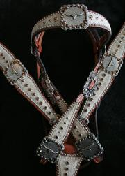 Chestnut oil leather browband headstall w/ matching breastcollar. Light Brindle hair-on, Ant. Silver and Gold longhorn hardware, Silver spots and Smoke Topaz Swarovskis.