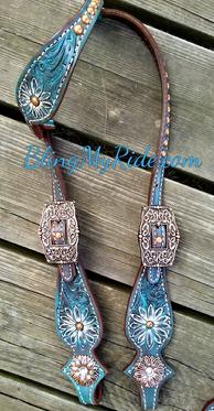 Antiques turquoise hand tooled daisies headstall with copper spots/hardware.