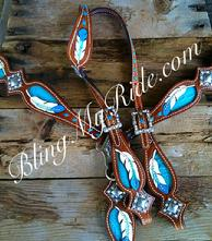 Hand tooled feather tack set with turquoise accents.