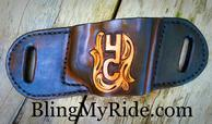 Custom hand tooled and painted pancake style gun holster.
