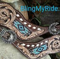 Beaded and hand tooled spur straps.