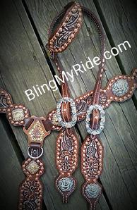 Hand tooled tack set with antique white and copper rose hardware.