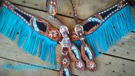 Gorgeous hand tooled and painted tack set with single ear headstall, black stingray inlays and turquoise fringe.
