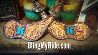Hand tooled butterfly spur straps.