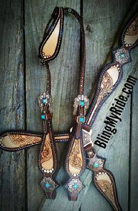 Hand tooled tack set with single ear headstall.