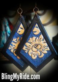 Hand tooled and painted leather earrings.