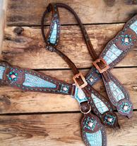 Dark oil bling tack set with Antique turquoise inlays and blue zircon Swarovskis on bronze hardware.