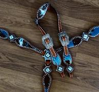 "Bling tack set. Turquoise acid wash hair-on, Aquamarine and Smoked Topaz Swarosvskis and Antique silver hardware. 1"" buckles."