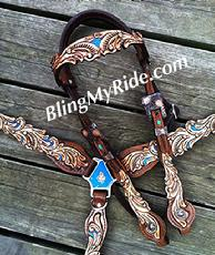Hand tooled scroll cut-out tack set with turquoise accents and browband headstall.