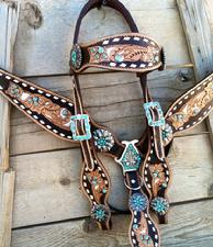 Hand tooled tack set with browband headstall.