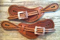 Hand stamped barb-wire boarder men's spur straps.