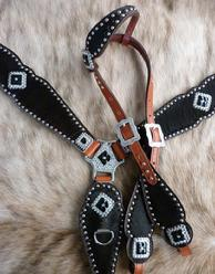 Black hair-on overlay bling tack set w/ single ear headstall. Jet and Clear Swarovskis, Antique Silver hardware and silver spots all on Herman Oak Leather.