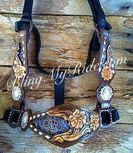 Hand tooled floral, inlaid, buckstitched bronc halter.