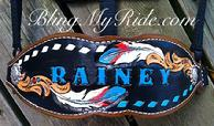 Hand tooled and customized bling feather bronc noseband.