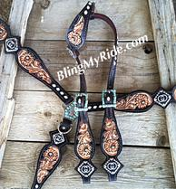 Custom hand tooled tack set with custom conchos.