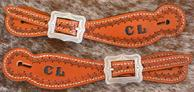 Hand stamped spur straps.