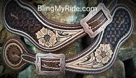 Hand tooled an dyed spur straps