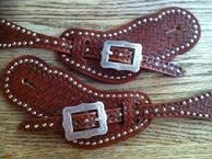 Mens hand stamped spur straps.
