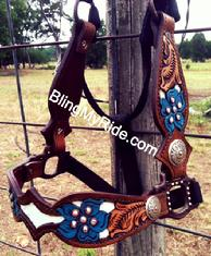 Hand tooled and inlaid full cheek halter.