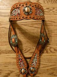 Bling Headstall. Turq. Floral embossed browband headstall w/ Bronze fancy dots, bronze hardware, and Aqua and Burgundy Swarovskis.
