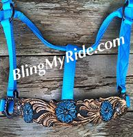 Hand tooled and painted bronc style noseband with turquoise flowers.