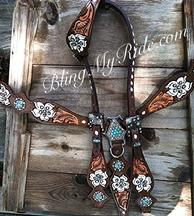 Hand tooled and painted floral tack set.