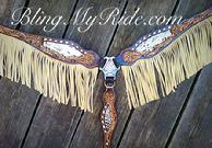 Hand tooled breastcollar with fringe and Swarovski crystals.