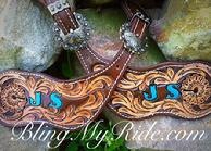 Hand tooled and painted spur straps with initials or brand.