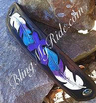 Purple, turquoise and white cuff bracelet. Hand tooled and painted feathers and cross.