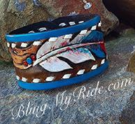 Hand tooled, painted and buck stitched leather cuff bracelet. Feathers and buckstitch