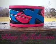 Hand tooled and painted cuff bracelet. Pink and turquoise feather and cross.