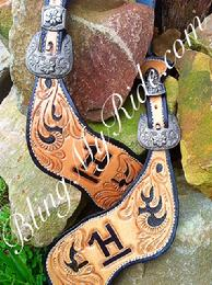 Hand tooled, and customized spur straps.