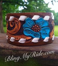 Hand tooled, painted and buckstitched leather cuff bracelet. Turquoise flower.