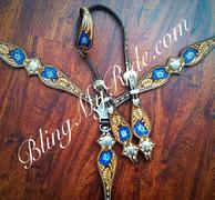 Hand tooled and painted tack set with single ear headstall. Buckstitched. Flowers are blue/white centers.