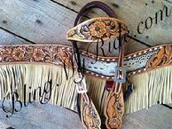 Hand tooled, buckstitched and inlaid tack set with browband and tripping collar. Floral and feather design.