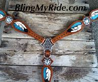 Hand tooled, painted and inlaid feather breastcollar.