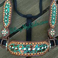 Metallic turquoise buckstitched halter with copper spots.