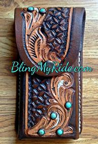 Hand tooled saddle mount cell phone holder.