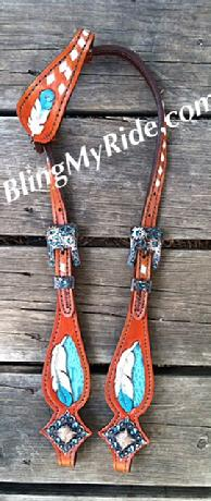 Hand tooled and painted feather headstall. Single ear, teal croc. inlay, teal tipped feathers. white bs.