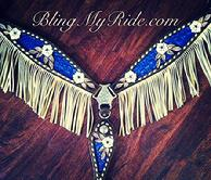 Hand tooled and croc. inlaid breastcollar with fringe.