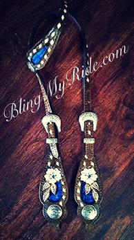 Hand tooled floral single ear headstall with royal blue croc. inlays and antique silver buckles and conchos.