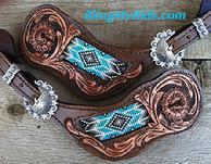 Hand tooled and beaded spur straps.