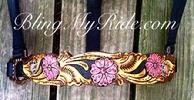Hand tooled and painted bronc style noseband with pink flowers.