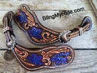 Hand tooled and painted spur straps.