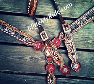 Hand tooled, beaded tack set with singel ear headstall.