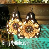 Hand tooled and buckstitched Leather sunflower earrings.