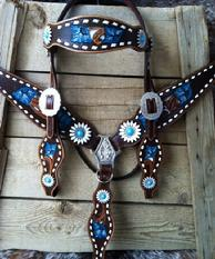Hand tooled, painted, dyed and buckstitche tack set. Turquoise fkowers.