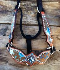 Turquoise acid wash bling bronc halter with fancy cheeks.