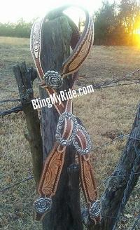 Hand tooled single ear headstall with silver rose hardware.